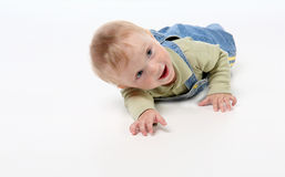 Laughing lying child Royalty Free Stock Photography