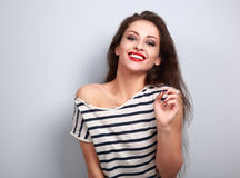 Laughing makeup young woman looking in casual wear on blue backg. Round Stock Photos