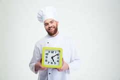 Laughing male chef cook holding wall clock Royalty Free Stock Photo