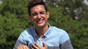 Laughing Male Hispanic Teenager. A handsome hispanic male teen stock video
