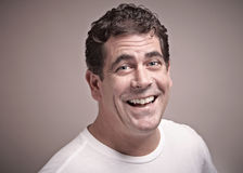 Laughing man. Laughing friendly man closeup portrait Royalty Free Stock Photography