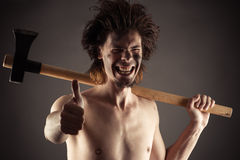Laughing man with an ax in hand Royalty Free Stock Photos