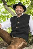 Laughing man in Bavarian costume Stock Photography