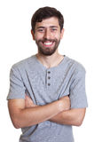 Laughing man with beard and crossed arms Stock Photo