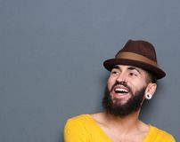 Laughing man with beard and piercings Stock Images
