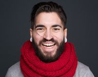 Laughing man with beard and scarf Stock Images