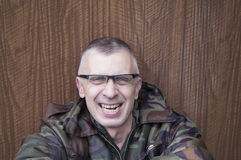 Laughing Man In Camouflage Royalty Free Stock Images