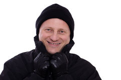 Laughing man with cap and leather gloves Stock Image