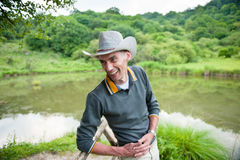 Laughing man in cowboy hat Stock Photos