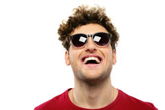 Laughing man with curly hair and sunglasses Royalty Free Stock Image