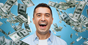 Laughing man with falling dollar money Stock Photography