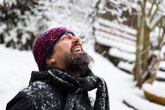 Laughing man in front of a snowy background Stock Images