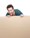 Laughing man holding blank poster stock photo