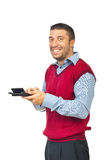 Laughing man holding calculator Royalty Free Stock Photo