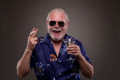 Laughing man with martini and cigarette Royalty Free Stock Image