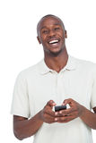 Laughing man with mobile phone. On a white background Stock Photography
