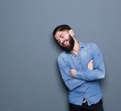 Laughing man with piercings Stock Images