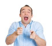 Laughing man pointing Stock Photo