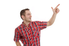 Laughing man pointing at something Stock Photo
