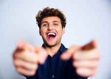 Laughing man pointing at you Stock Photo