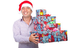 Laughing man with Santa hat hold gifts Royalty Free Stock Images