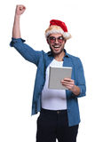 Laughing man in santa manwith pad  is winning Royalty Free Stock Photography