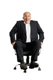 Laughing man sitting on office chair Stock Images