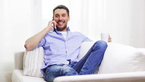 Laughing man with smartphone at home stock footage