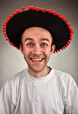 Laughing man in sombrero hat. Very happy stupid laughing man in sombrero hat Stock Photography