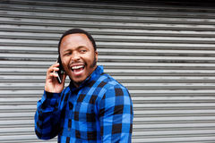 Laughing man talking on mobile phone Stock Photo