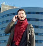 Laughing man talking on phone outdoors Royalty Free Stock Photos