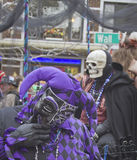 Laughing Mardi Gras Fool and Death Skull Stock Photo