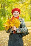 Laughing mature  in autumn park Royalty Free Stock Image