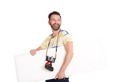 Laughing mature photographer with blank poster Royalty Free Stock Images