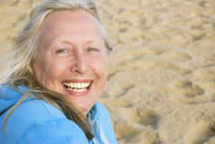 Laughing mature woman. stock photo