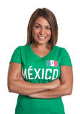 Laughing mexican girl with crossed arms Stock Image