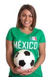 Laughing mexican girl with football Royalty Free Stock Photography