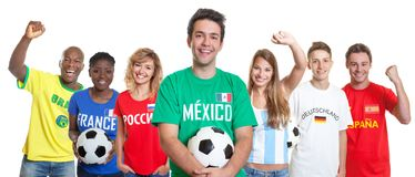 Laughing mexican soccer supporter with ball and fans from other royalty free stock photos