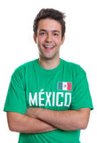Laughing mexican sports fan with crossed arms. Sports fan from Mexico with crossed arms in  a green jersey on an isolated white background Stock Photography