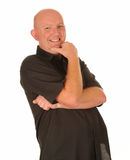 Laughing middle aged man. Half body portrait of bald middle aged man laughing, white studio background Royalty Free Stock Images