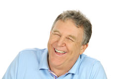 Laughing Middle Aged Man. Close up of a middle aged man laughing heartily looking away from camera Stock Image