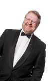 Laughing middle aged man in tuxedo on white Stock Photo