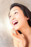 Laughing model on golden background Royalty Free Stock Photo