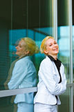 Laughing modern business woman  at office building Royalty Free Stock Images
