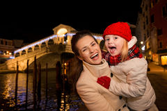 Laughing mother and daughter in Christmas decorated Venice Stock Photography