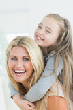 Laughing mother and daughter Stock Images
