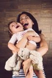 Laughing Mother and Daughter Royalty Free Stock Photography