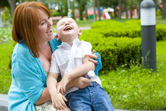 Laughing mother and her four-year-old son Royalty Free Stock Photos