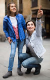Laughing mother pointing to daughter new sight Stock Photography