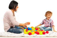 Laughing mother and son with balls Royalty Free Stock Image